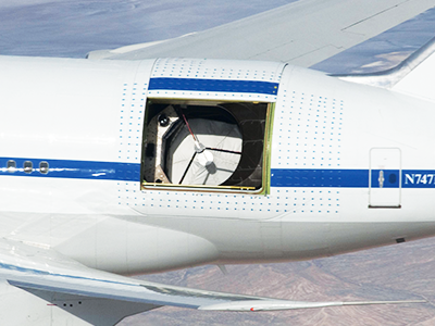 NASA's Stratospheric Observatory for Infrared Astronomy telescope, scanning from inside a Boeing 747 jumbo jet.
