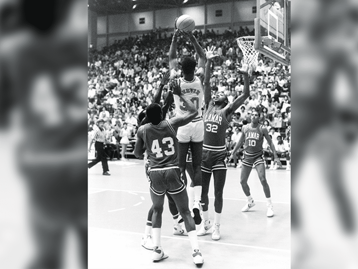 Gervin launches a shot against Lamar University.