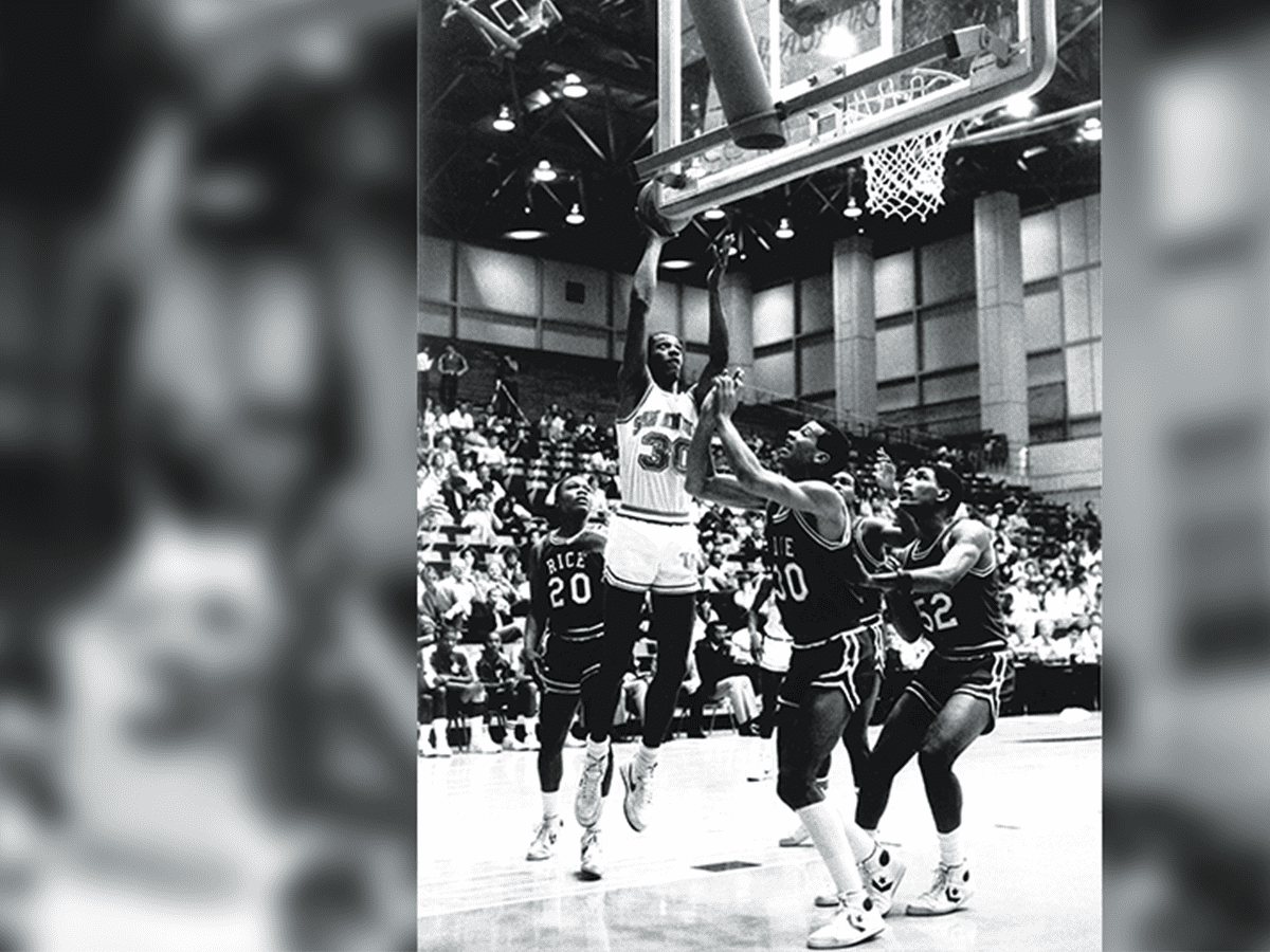 Gervin shoots a scoring hoop in a game against Rice on December 10, 1984, in his junior year. An All-America candidate that season, he was the nation's ninth leading scorer.