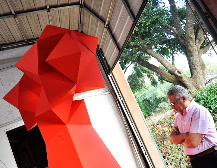 UTSA Libraries Art Collection curator Arturo Infante Almeida looks over one of the largest of Sebastian's pieces to be relocated to Main Campus