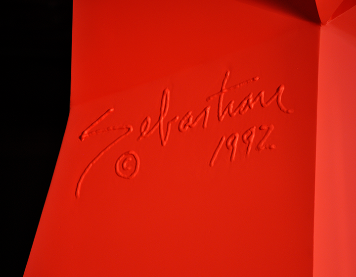 A closeup of Sebastian's signature that's been forged into his work