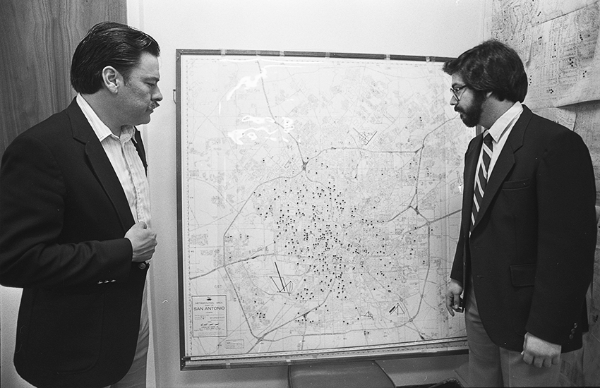 Voting rights advocates Willie Velasquez and Andy Hernandez display a map of Mexican American voter polling in San Antonio