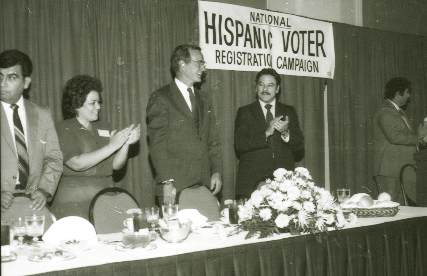 Presidential candidate George H.W. Bush attends a Hispanic voter registration campaign event with Willie Velasquez