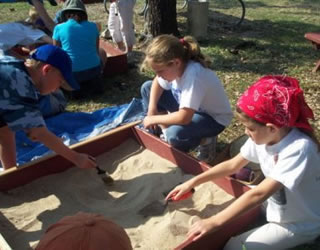 students using sand tray