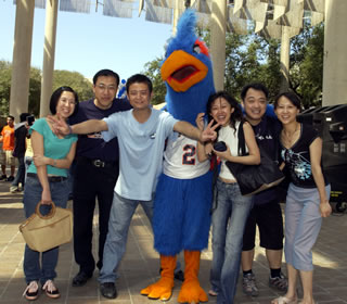 Rowdy Roadrunner and students