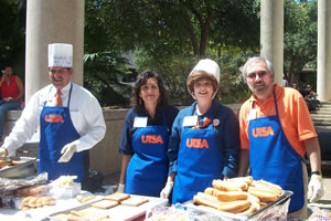 administrators serve food at Week of Welcome event