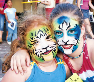 girls in face paint at Texas Folklife Festival