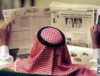 Arab reading newspaper