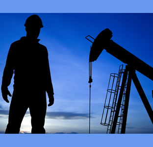 man at oil well