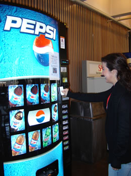 student at soda machine