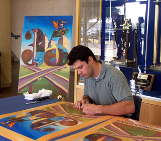 Logan Blanco signs posters