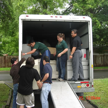 Volunteers load a truck